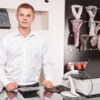 Young male sales assistant at work — Stock Photo #78312570