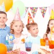 Children posing with birthday party equipment — Stock Photo #80147884