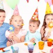 Children posing with birthday party equipment — Stock Photo #80147892