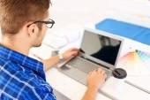 Positive freelancer working on the laptop — Stock Photo