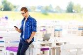 Pleasant guy holding mobile phone — Stock Photo