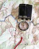 Navigating with compass with map — Stock Photo