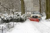 Truck snowplowing fresh snow on road after snowstorm — Stock Photo