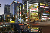 Tokyo. Circa November 2014. Despite reports of a slowing Japanese economy, the neon lights of Shinjuku reflect a vibrant hub of retail and commercial business, restaurants and entertainment. — Stock Photo