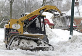 Construction equipment clearing snow on street after snowstorm — Stock Photo