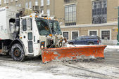 Truck with snowplow on road after snowstorm — Stock Photo