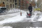 Resident with snowblower on street after snowstorm — Stock Photo