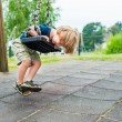 Cute toddler boy playing on playground — Stock Photo #59230013