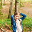 Autumn portrait of a cute little girl in forest on a sunny day — Stock Photo #59230739