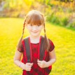 A young little girl preparing to walk to school — Stock Photo #59230961
