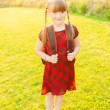 A young little girl preparing to walk to school — Stock Photo #59231105