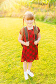 A young little girl preparing to walk to school — Stock Photo