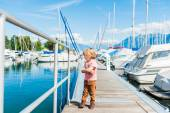 Outdoor portrait of a cute toddler boy in a port, on a nice sunny day — Zdjęcie stockowe