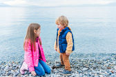 Adorable children playing together outdoors — Stock Photo