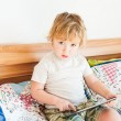 Adorable toddler boy playing on tablet pc on a nice sunny morning indoors — Stock Photo #59307691
