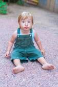 Portrait of adorable toddler boy with funny expression on his face — Stock Photo
