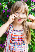 Close-up portrait of a cute little girl at summer vacation — Stock Photo