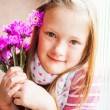 Kid girl with pink flowers, close up portrait — Stock Photo #59710623