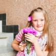 Kid girl with pink flowers, close up portrait — Stock Photo #59710717