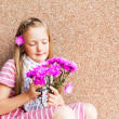 Kid girl with pink flowers, close up portrait — Stock Photo #59710787