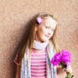 Kid girl with pink flowers, close up portrait — Stock Photo #59711041