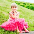 Summer portrait of a cute little, girl in a bright pink skirt tutu — Stock Photo #59711843