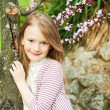 Outdoor portrait of a cute little girl, on a nice spring day — Stock Photo #59715147