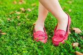 Close up of red moccasins on child's feet — Stock Photo