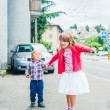Adorable kids walking in a city on a nice day — Stock Photo #59720353