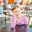 Outdoor portrait of a cute little girl on a nice sunny day — Stock Photo #59796909