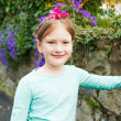 Outdoor portrait of a cute little girl on a nice sunny spring day — Stock Photo #59798393