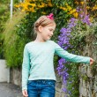Outdoor portrait of a cute little girl on a nice sunny spring day — Stock Photo #59798403