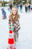 Cute little girl learning to skate with the support on a nice winter day — Stock Photo
