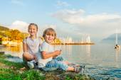Adorable kids having fun outdoors, playing by the lake on a beautiful sunset — Stockfoto