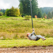 Cute toddler boy playing on a chain swing, having fun in a park on a nice autumn day — Stock Photo #64930015