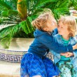 Two adorable kids on vacation, big sister giving a hug to her toddler brother — Stock Photo #64930931