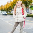 Pretty little girl with backpack ready to go to school, wearing warm white coat — Stock Photo #64939207