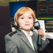 Adorable toddler boy spend the day at his parent's work in a trading room at the bank — Stock Photo #64944839