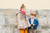 Fashion portrait of adorable kids outdoors — Stock Photo