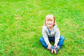 Adorable little boy playing outdoors — Stock Photo