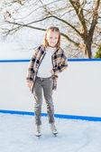 Little girl on skating rink — Stock fotografie