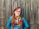 Outdoor portrait of a cute little girl in glasses, toned image — Stock Photo