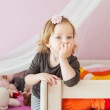 Interior portrait of a cute toddler girl in her room — Stock Photo #66845851