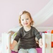 Interior portrait of a cute toddler girl in her room — Stock Photo #66845889