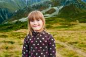 Close up portrait of a cute little girl hiking in mountains, wearing warm fleece jacket — Stock Photo