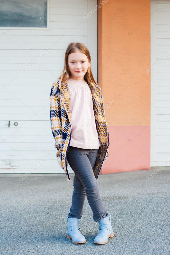outdoor portrait of a cute little girl wearing plaid