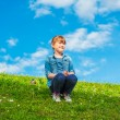 Summer portrait of a cute little girl playing outdoors — Stock Photo #70531895