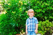 Outdoor portrait of a cute little boy, wearing plaid blue shirt — Foto Stock