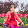 Outdoor portrait of a cute little girl of 7 years old, wearing bright pink jacket, holding umbrella — Stock Photo #71820127