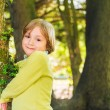 Outdoor portrait of a cute little blond boy playing in the park — Stock Photo #72876291